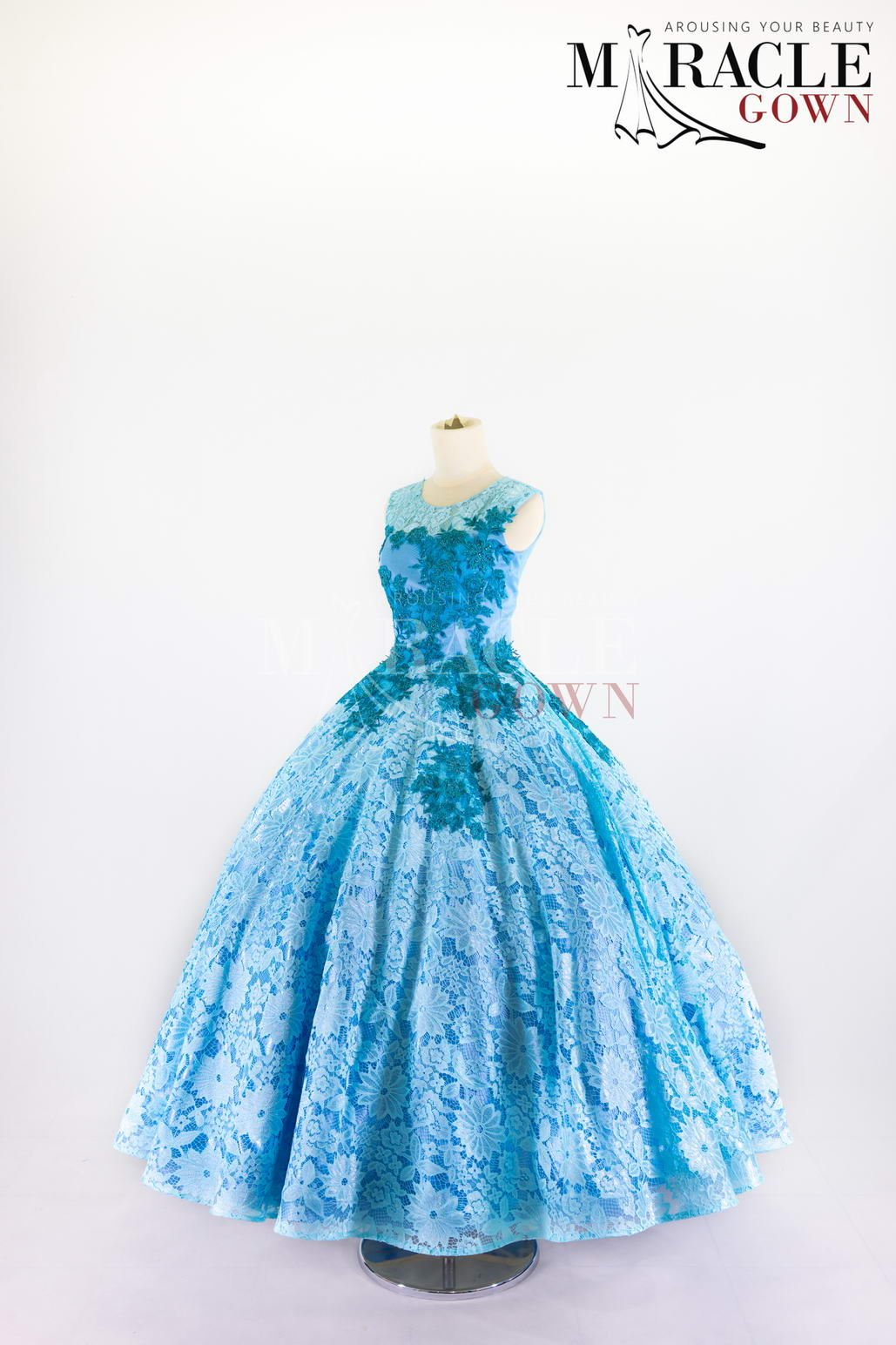 Sewa Gaun Surabaya - Miracle Gown - Topaz blue brocade laced in full cloack gown